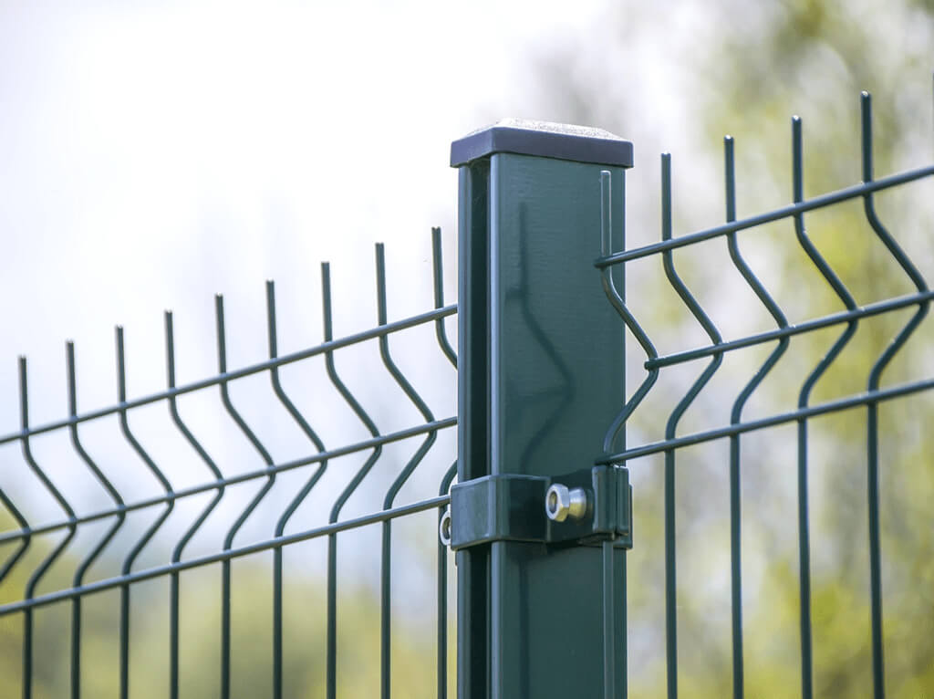 Fencing Contractors in Plymouth: Image of green metal palisade commercial fencing.