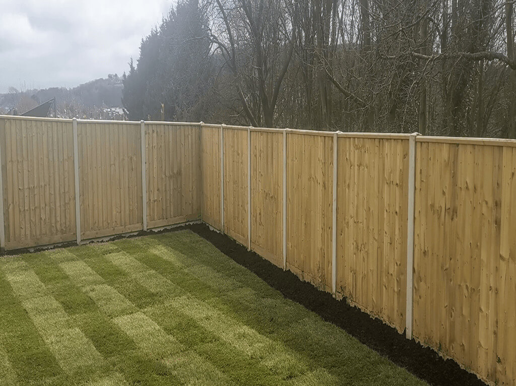 Fencing Contractors in Plymouth: Image of feather edge fencing in a garden.