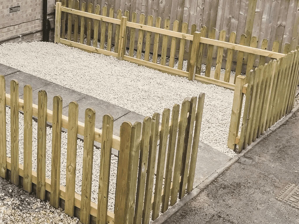 Fencing Contractors in Plymouth: Image of picket fencing in a front garden.