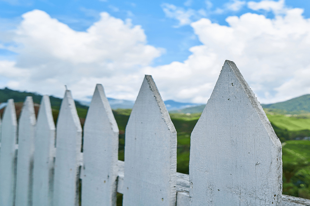 Fencing Repair - Image of white picket fencing.