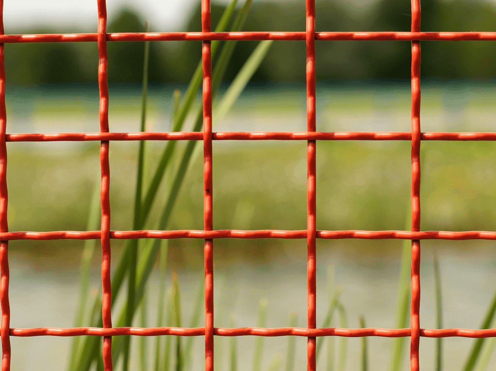 Fencing Contractors in Plymouth: Image of red wire agricultural fencing.