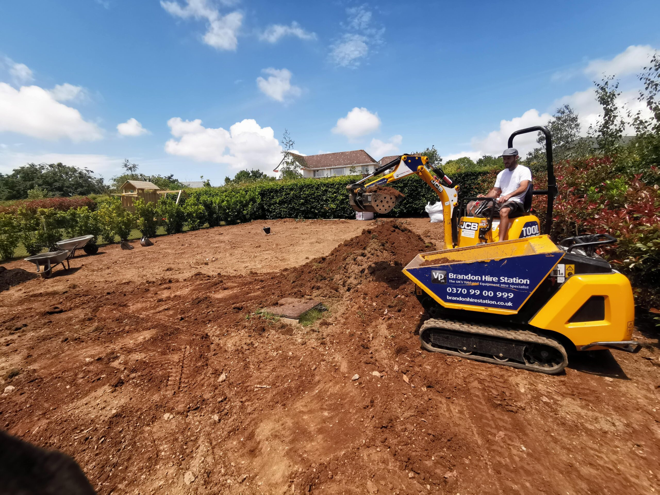 Garden Clearance: Image of a JCB in action.
