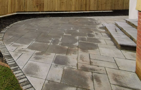 Patio Laying: Image of a curved grey patio.