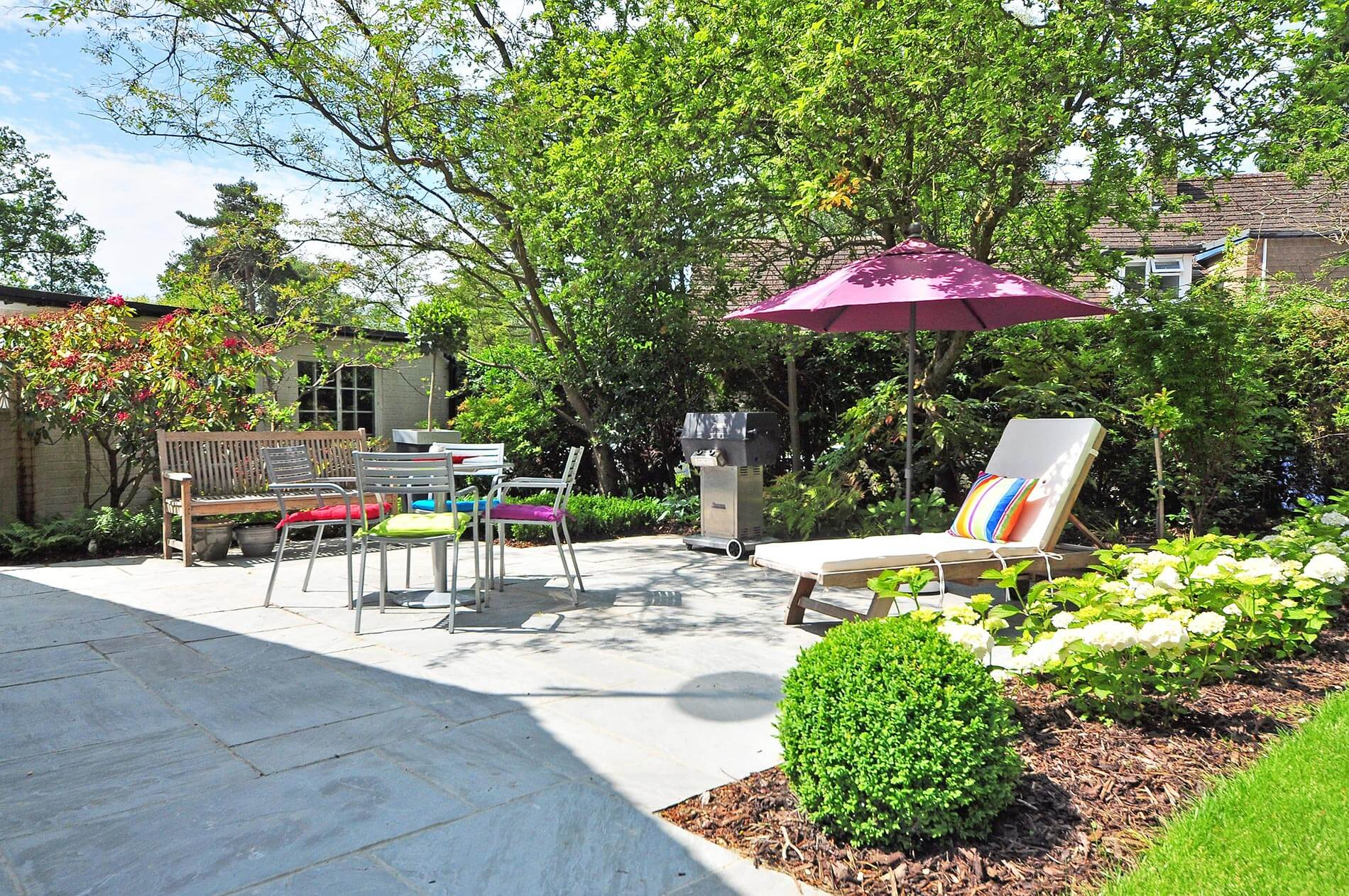 Patio Laying: Image of a garden with a paved patio area.