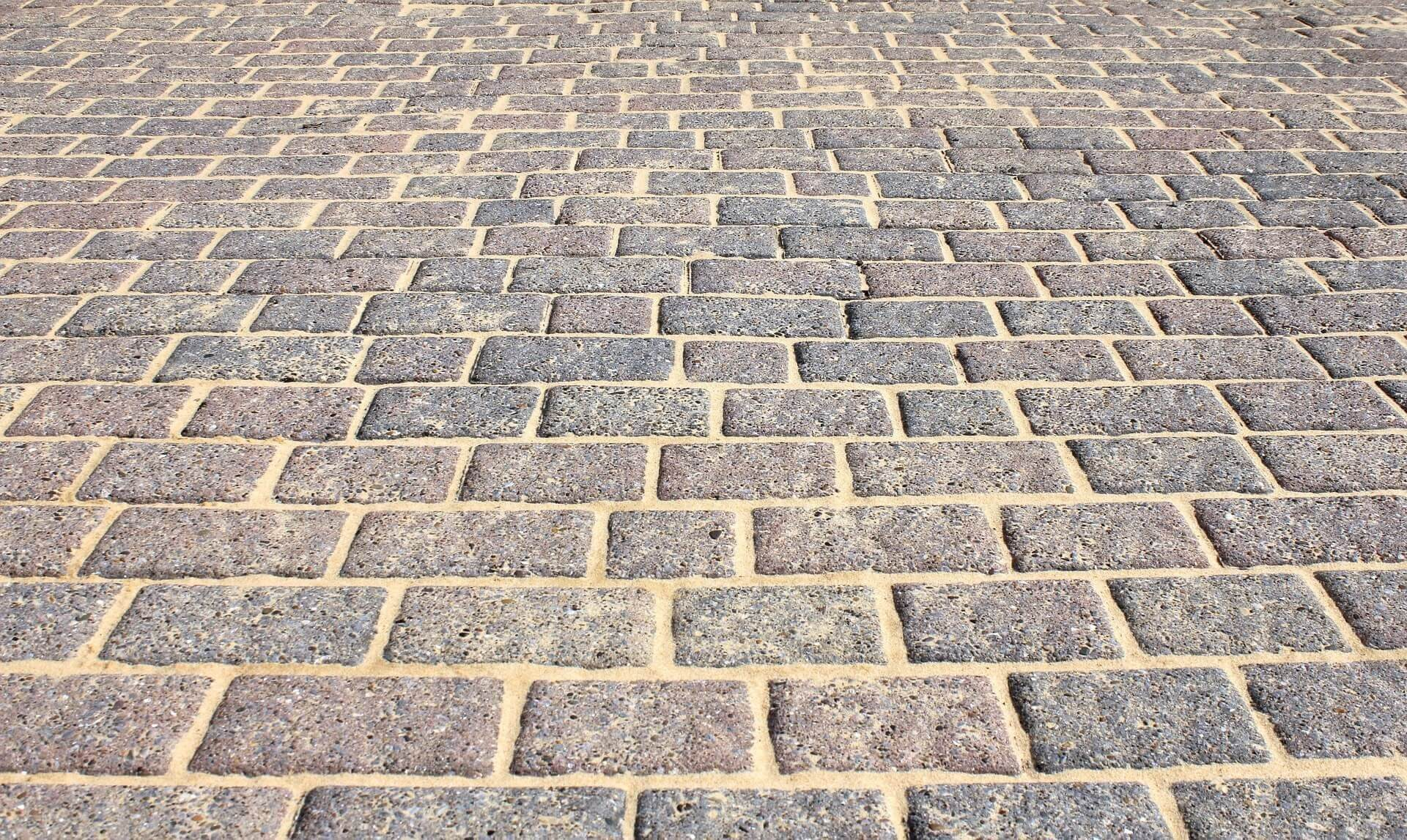 Patio Laying: Image of a block paved driveway.